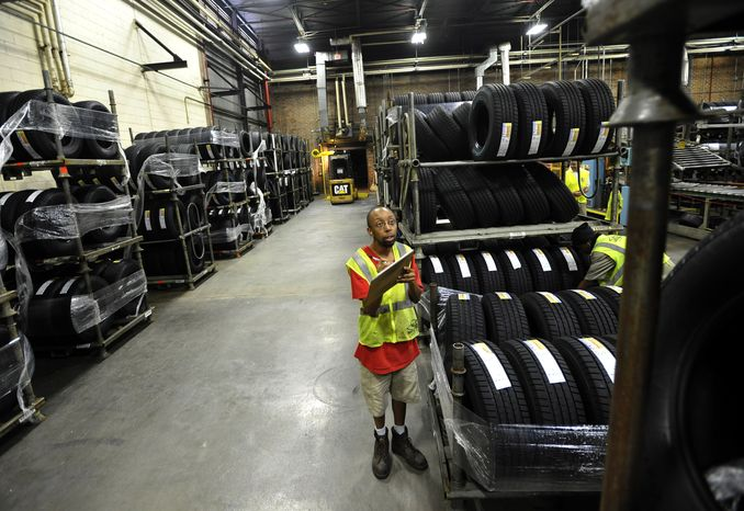 Forklift driver Clyde Boyce takes inventory in the warehouse at a Michelin tire manufacturing plant in Greenville, S.C., on Tuesday, July 24, 2012. (AP Photo/Rainier Ehrhardt)