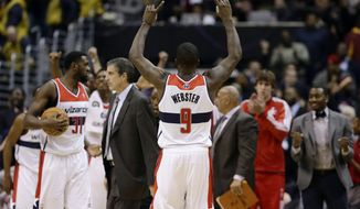 Washington Wizards forward Martell Webster celebrates in the second half of an NBA basketball game against the Portland Trail Blazers on Wednesday, Nov. 28, 2012, in Washington. The Wizards won 84-82, their first victory this season after 12 losses. (AP Photo/Alex Brandon)
