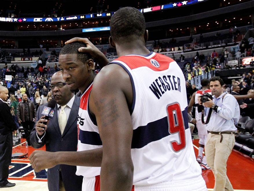Washington Wizards guard Jordan Crawford, center, receives congratulations forward Martell Webster react after an NBA basketball game against the Portland Trail Blazers on Wednesday, Nov. 28, 2012, in Washington. The Wizards won for the first time this season, 84-82. (AP Photo/Alex Brandon)