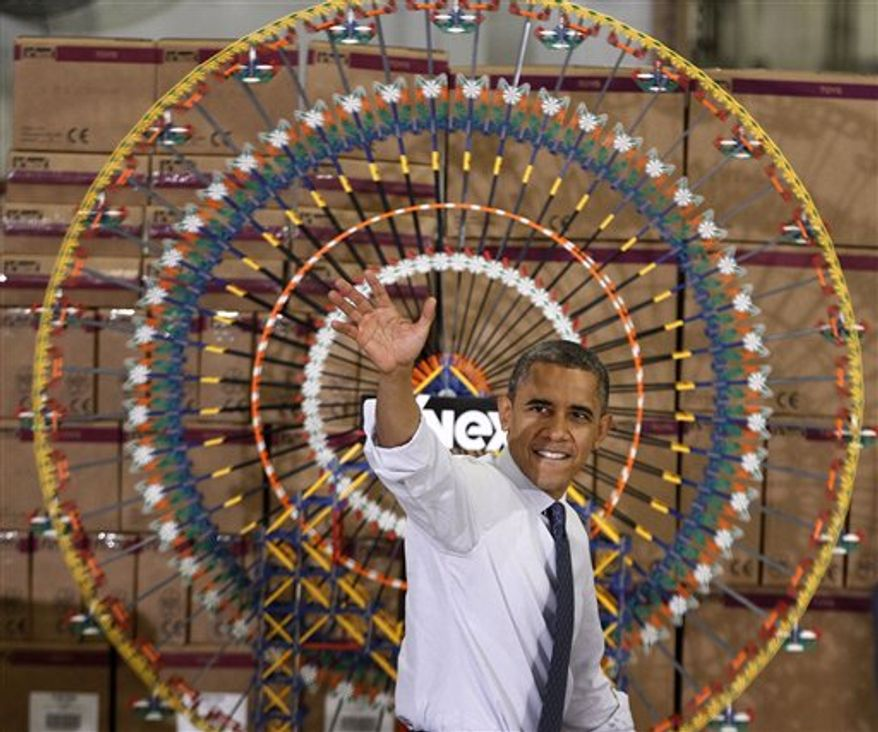 President Barack Obama waves after speaking at the Rodon Group, which manufactures over 95% of the parts for K'NEX Brands toys, Friday, Nov. 30, 2012, in Hatfield, Pa. The visit comes as the White House continues a week of public outreach efforts, while also attempting to negotiate a deal with congressional leaders. (AP Photo/The Philadelphia Inquirer, Michael S. Wirtz)