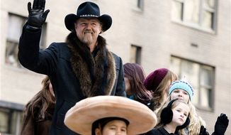 ** FILE ** In this Thursday, Nov. 22, 2012, file photo, Trace Adkins rides a float in the Macy's Thanksgiving Day Parade in New York. Adkins wore an earpiece decorated like the Confederate flag when he performed for the Rockefeller Center Tree Lighting on Nov. 28, but he said he didn't mean to offend anyone by wearing it. (AP Photo/Charles Sykes, File)