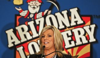 Karen Bach, director of Budget, Products and Communications of the Arizona Lottery, announces during a news conference that one of the winning tickets in the $579.9 million Powerball jackpot was purchased in Fountain Hills, Ariz., Thursday, Nov. 29, 2012, in Phoenix. (AP Photo/Ross D. Franklin)