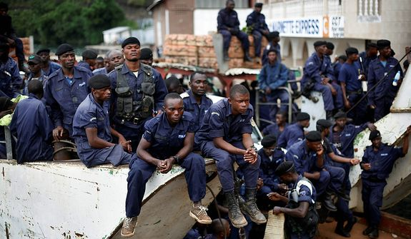 Police Nationale du Congo officers who fled Goma when M23 rebels took over the city Nov. 18 2012, return on a barge to the port of Goma, eastern Congo, Friday Nov. 30, 2012. The police force were returning to resume control on Friday, as had been agreed by the regional bloc. Rebels in Congo believed to be backed by Rwanda postponed their departure Friday from the key eastern city of Goma by 48 hours for ìlogistical reasons,î defying for a second time an ultimatum set by neighboring African countries and backed by Western diplomats. The delay raises the possibility that the M23 rebels donít intend to leave the city they seized last week, giving credence to a United Nations Group of Experts report which argues that neighboring Rwanda is using the rebels as a proxy to annex territory in mineral-rich eastern Congo.(AP Photo/Jerome Delay)