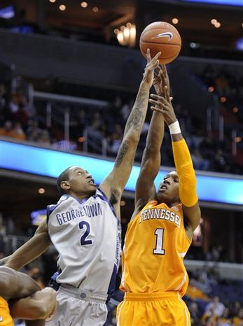 Tennessee guard Josh Richardson (1) tries to shoot over Georgetown forward Greg Whittington (2) during the first half of an NCAA college basketball game, Friday, Nov. 30, 2012, in Washington. (AP Photo/Nick Wass)