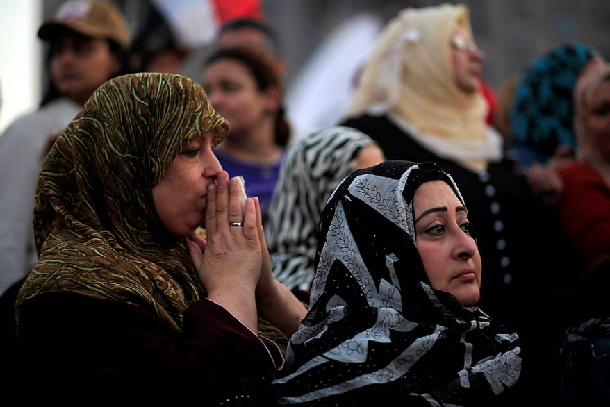 Demonstrators react to speeches in Tahrir Square, where liberal and secular parties are holding major protests against Egyptian President Mohammed Morsi's latest decrees granting himself almost complete powers and allowing a rushed constitution to be presented for a vote, Friday, Nov. 30, 2012. (AP Photo/Thomas Hartwell)