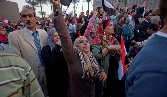 Demonstrators chant slogans and wave Egyptian flags in Tahrir Square where liberal and secular parties are holding major protests against Egyptian President Mohammed Morsi's latest decrees granting himself almost complete powers and allowing a rushed constitution to be presented for a vote, Friday, Nov. 30, 2012. (AP Photo/Thomas Hartwell)