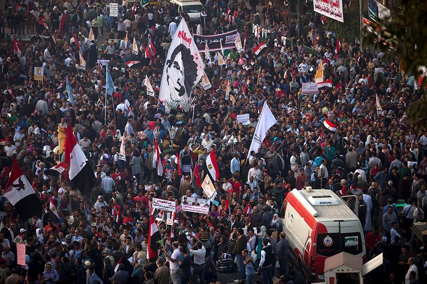 Protesters gather in Tahrir Square, where liberal and secular parties are holding major protests against Egyptian President Mohammed Morsi's latest decrees granting himself almost complete powers and allowing a rushed constitution to be presented for a vote, Friday, Nov. 30, 2012. (AP Photo/Thomas Hartwell)