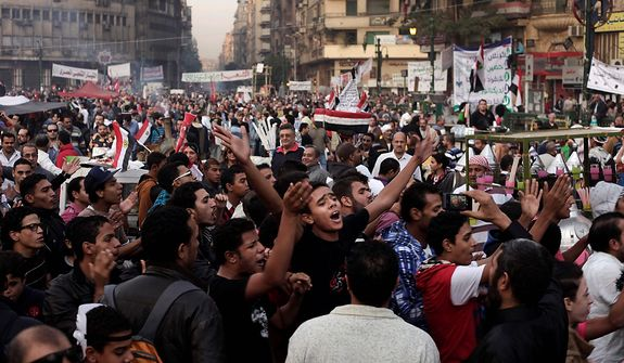 Egyptians chant slogans during a demonstration in Tahrir Square, Cairo, Egypt, Friday, Nov. 30, 2012. Liberal and secular parties held major protests against Egyptian President Mohammed Morsi's latest decrees granting himself almost complete powers. (AP Photo/Nariman El-Mofty)