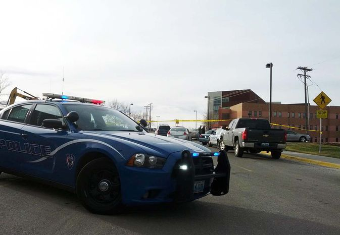 Police investigate a homicide at Casper College on Friday morning, Nov. 30, 2012, in Casper, Wyo. At least one person was killed and another was wounded Friday in an attack at Casper College, a community college in central Wyoming. It happened around 9 a.m., said school spokesman Rich Fujita. (AP Photo/Casper Star-Tribune, Alan Rogers)