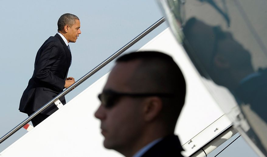 President Barack Obama walks up the steps of Air Force One at Andrews Air Force Base, Md., Friday, Nov. 30, 2012. Obama will visit K'NEX, a construction toy company based in Hatfield, Pa. The visit comes as the White House continues a week of public outreach efforts, while also attempting to negotiate a deal with congressional leaders. (AP Photo/Susan Walsh)