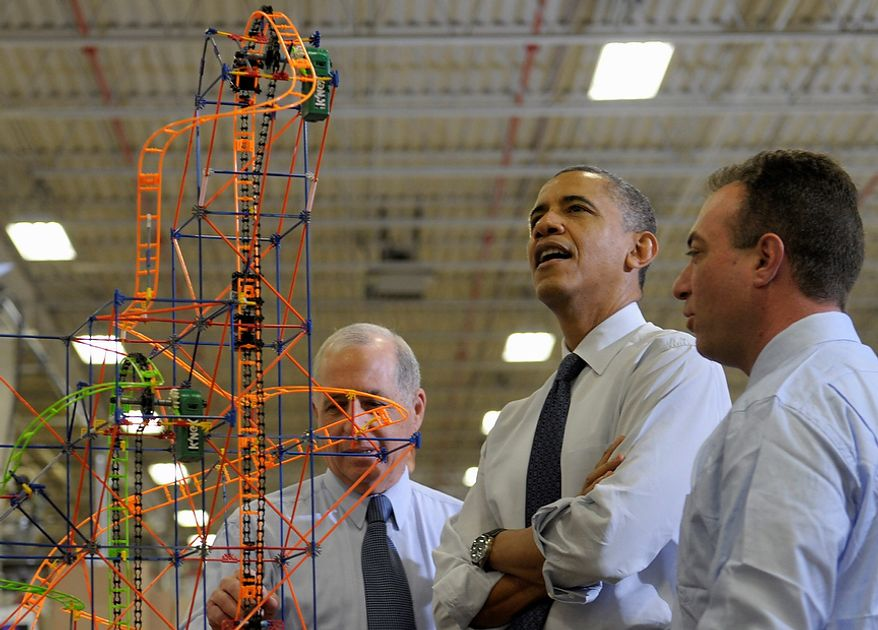 President Barack Obama looks over a rollercoaster with K'NEX Inventor Joel Glickman, left, and Rodon Group President and Chief Executive Officer Michael Araten, right, during a tour of the company in Hatfield, Pa. Friday, Nov. 30, 2012. The visit comes as the White House continues a week of public outreach efforts, while also attempting to negotiate a deal with congressional leaders. The Rodon Group manufactures over 95% of the parts for KÃŒNEX Brands toys. (AP Photo/Susan Walsh)