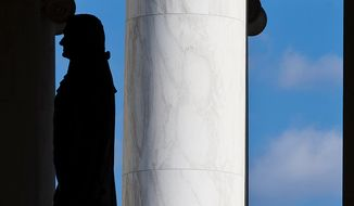 A man admires the 19-foot-tall, 10,000-pound bronze statue of our third President of the United States, Thomas Jefferson, inside the Jefferson Memorial in Washington, D.C., on Wednesday, November 28, 2012. (Craig Bisacre/The Washington Times)