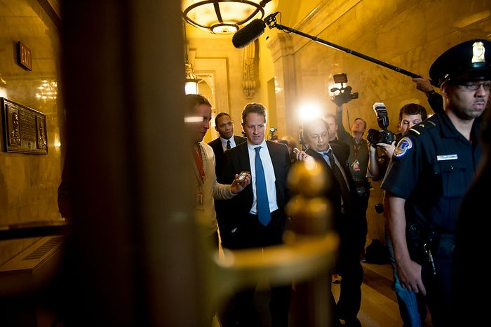 U.S. Treasury Secretary Tim Geithner, center, departs after meeting with House Minority Leader Nancy Pelosi (D-Calif.) at the U.S. Capitol Building, Washington, D.C., Thursday, November 29, 2012. (Andrew Harnik/The Washington Times)