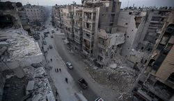In this Thursday, Nov. 29, 2012, photo, destroyed buildings, including Dar Al-Shifa hospital, are seen on Sa'ar street after airstrikes targeted the area in Aleppo, Syria. (AP Photo/Narciso Contreras)