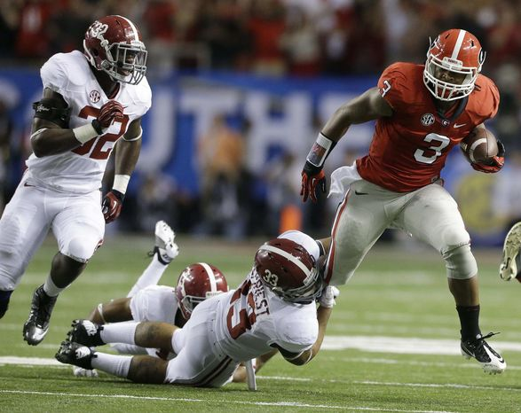 Georgia running back Todd Gurley (3) breaks the tackle of Alabama linebacker Trey DePriest (33) during the first half of the Southeastern Conference championship NCAA college football game, Saturday, Dec. 1, 2012, in Atlanta. (AP Photo/David Goldman)