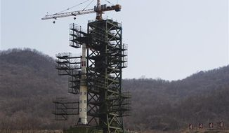 ** FILE ** In this April 8, 2012, file photo, North Korea's Unha-3 rocket stands at Sohae Satellite Station in Tongchang-ri, North Korea. The nation said Saturday, Dec. 1, 2012, it will launch a long-range rocket between Dec. 10 and Dec. 22. (AP Photo/David Guttenfelder, File)