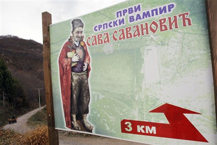 "In this Nov. 30, 2012, photo a billboard showing an impression of the legendary ghost Sava Savanovic. The poster reads ""First Serbian vampire"", near the village of Zarozje, near the Serbian town of Bajina Basta. (AP Photo/Darko Vojinovic)"