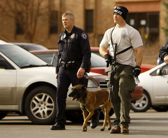 Casper police leave the Wold Physical Science Building while investigating a murder and suicide at Casper College, Friday Nov. 30, 2012, in Casper, Wyo. Two people were killed by a sharp object, according to Casper police. The attacker then killed himself. (AP Photo/Dan Cepeda, Casper Star-Tribune)