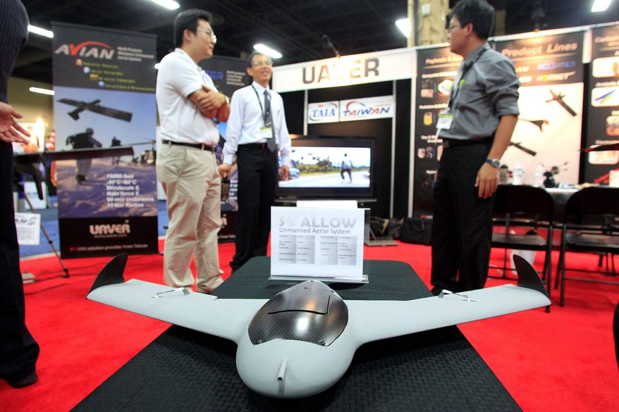 A vehicle from the Swallow Unmanned Aerial System was displayed at the Unmanned Vehicle Systems International convention in Las Vegas this year. Media, agriculture and real estate industries are expected to be among the most eager customers for drones. (Sam Morris/Special to The Washington Times)