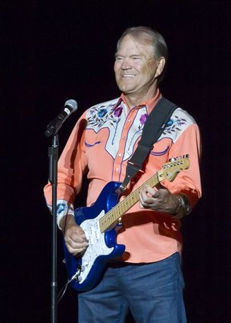 ** FILE ** In this Sept. 6, 2012, file photo, singer Glen Campbell performs during his Goodbye Tour in Little Rock, Ark. Campbell finished off his Goodbye Tour on Friday night, Nov. 30, 2012, in Napa, Calif., but is considering scheduling more dates in 2013. The singer has Alzheimer's disease. (AP Photo/Danny Johnston, File)