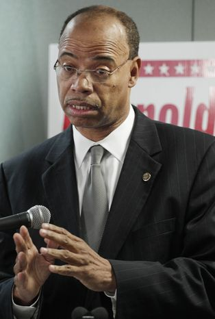 Convicted former Congressman Mel Reynolds announces at a news conference Wednesday, Nov. 28, 2012, in Chicago that he's joining the increasingly crowded field running for the congressional seat Jesse Jackson Jr. vacated last week. Reynolds resigned from office in 1995 after being convicted of having sexual relations with an underage campaign worker. The Democrat also went to prison after being convicted of fraud for concealing debts
