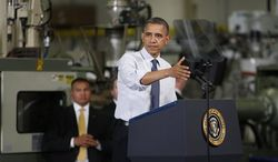 President Obama gestures as he speaks at The Rodon Group manufacturing facility, Friday, Nov. 30, 2012, in Hatfield, Pa. Obama spoke at the toy company about how middle class Americans would see their taxes go up if Congress fails to act to extend the middle class tax cuts. (AP Photo/The Philadelphia Inquirer, Michael S. Wirtz)