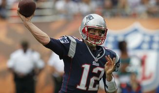 New England Patriots quarterback Tom Brady (12) looks to pass during the first half of an NFL football game against the Miami Dolphins, Sunday, Dec. 2, 2012, in Miami. (AP Photo/Wilfredo Lee)