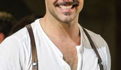 """Ricky Martin appears at the curtain call after his first performance in the new Broadway revival of """"Evita"""" in New York on Monday, March 12, 2012. (AP Photo/Charles Sykes)"""