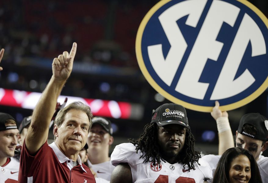 Alabama head coach Nick Saban and running back Eddie Lacy after their 32-28 win in the Southeastern Conference championship NCAA college football game against Georgia, Saturday, Dec. 1, 2012, in Atlanta. (AP Photo/David Goldman)