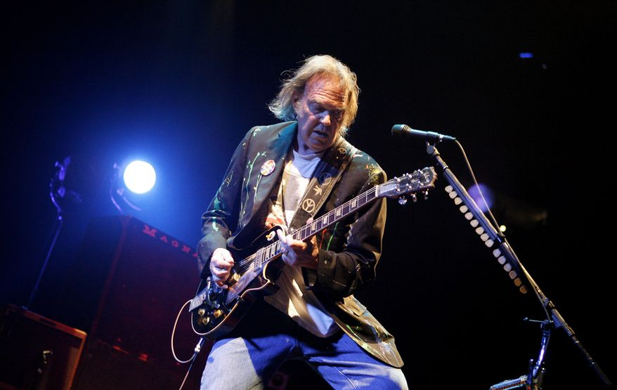 Neil Young performs at Madison Square Garden in New York on Monday, Dec. 15, 2008. (AP Photo/Jason DeCrow)