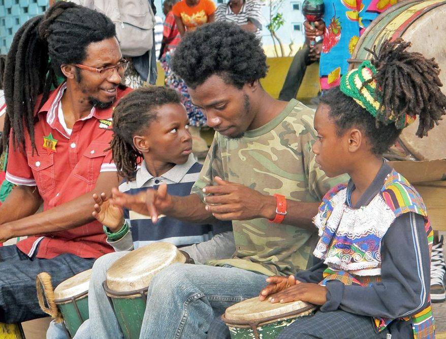 Rastafarian followers play drums and chant in Papine, a community on the outskirts of Kingston. Rastafarianism melds Old Testament teachings and Pan-Africanism. (Associated Press)
