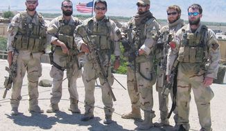"Marcus Luttrell, author of ""Lone Survivor,"" (third from right) was the only Navy SEAL to survive a botched 2005 mission in Afghanistan. (U.S. Navy) ** FILE **"