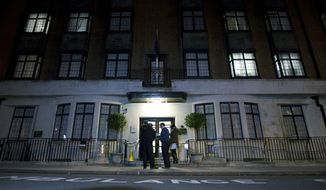 Policeman stand guard Dec. 3, 2012, outside the King Edward VII hospital in London, where the Duchess of Cambridge has been admitted with a severe form of morning sickness. Prince William and his wife Kate are expecting their first child. (Associated Press)