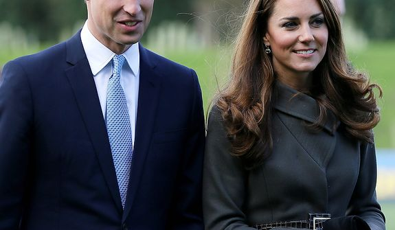 **FILE** Britain's Prince William (left) and his wife Kate, the Duchess of Cambridge, visit a football training pitch at St. George's Park near Burton Upon Trent in Staffordshire, England, on Oct. 9, 2012. (Associated Press)