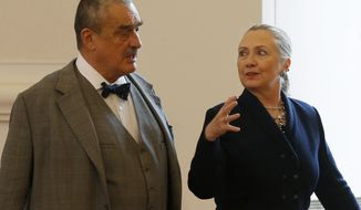 Czech Foreign Minister Karel Schwarzenberg (left) and U.S. Secretary of State Hillary Rodham Clinton arrive for a press conference in Prague on Monday, Dec. 3, 2012. (AP Photo/Petr David Josek)