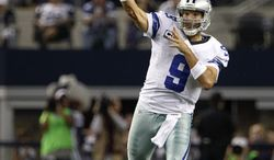 Dallas Cowboys quarterback Tony Romo  passes against the Philadelphia Eagles during an NFL football game Sunday, Dec. 2, 2012, in Arlington, Texas. The Cowboys won 38-33. (AP Photo/Tony Gutierrez)