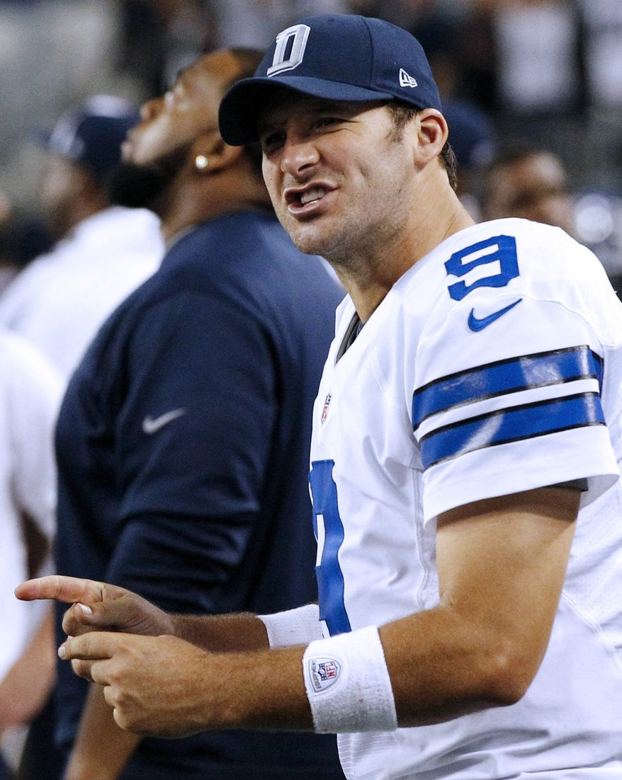 Dallas Cowboys quarterback Tony Romo (9) celebrates on the sideline during the second half of an NFL football game against the Philadelphia Eagles on Sunday, Dec. 2, 2012 in Arlington, Texas. The Cowboys won 38-33. (AP Photo/Tony Gutierrez)