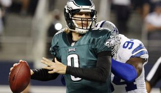 Philadelphia Eagles quarterback Nick Foles (9) is hit by Dallas Cowboys outside linebacker DeMarcus Ware (94) during the first half of an NFL football game, Sunday, Dec. 2, 2012, in Arlington, Texas. (AP Photo/LM Otero)