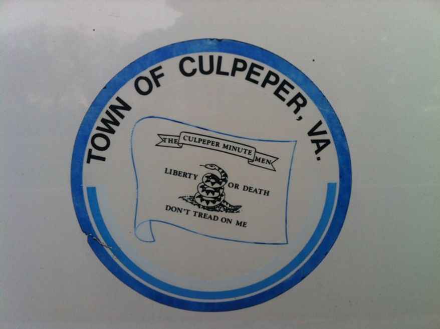 The current logo for Culpeper, Va., is displayed on a town vehicle. (The Washington Times)