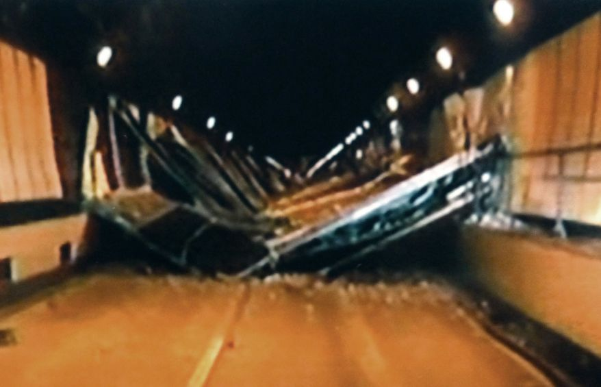 This image from video footage taped Sunday afternoon, Dec. 2, 2012, by the Yamanashi Prefectural Police shows collapsed concrete ceiling panels inside the Sasago Tunnel on the Chuo Expressway in Koshu, Yamanashi Prefecture, in central Japan. (AP Photo/Kyodo News)
