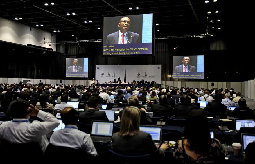 Participants listen to the speech of Hamdoun Toure, Secretary General of International Telecommunication Union, on the eleventh day of the World Conference on International Telecommunication in Dubai, United Arab Emirates, on Dec. 3, 2012. (Associated Press)