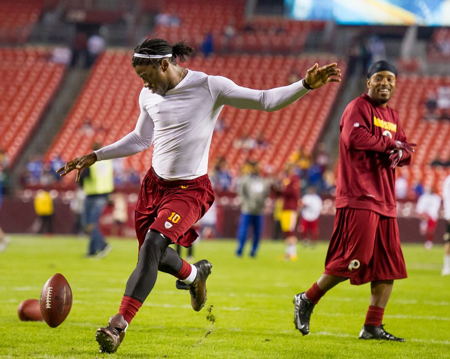 Washington Redskins wide receiver Santana Moss (89), right, laughs as quarterback Robert Griffin III (10) attempts a field goal during warms up before the Washington Redskins play the New York Giants for Monday Night Football at FedEx Field, Landover, Md., Monday, December 3, 2012. (Andrew Harnik/The Washington Times)