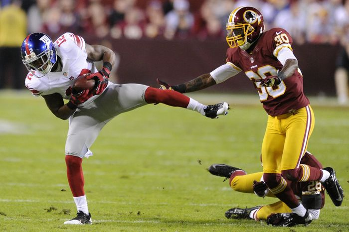 New York Giants wide receiver Jerrel Jernigan (12) hauls in a first down reception in front of Washington Redskins defensive back DJ Johnson (30) and cornerback Josh Wilson (26) in the first quarter