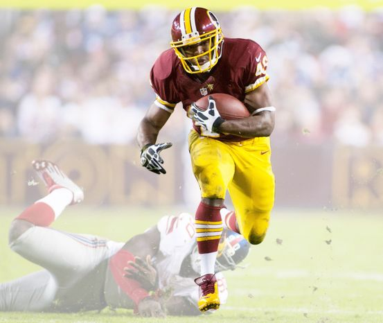 The Redskins lead the NFL in rushing at 167.2 yards per game. Running back Alfred Morris has rushed for a franchise rookie record 1,106 yards. (Craig Bisacre/The Washington Times)
