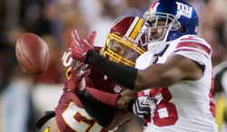 craig bisacre/the washington times Redskins defensive back Cedric Griffin (left) has 33 tackles, four pass breakups and one forced fumble in nine games this season.