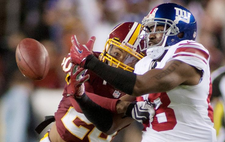 craig bisacre/the washington times Redskins defensive back Cedric Griffin (left) has 33 tackles, four pass breakups