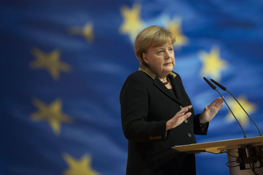 German Chancellor Angela Merkel, who also is chairwoman of the Christian Democratic Party (CDU), delivers her keynote speech at the party's 2012 convention in Hanover, Germany, on Tuesday, Dec. 4, 2012. (AP Photo/Markus Schreiber)