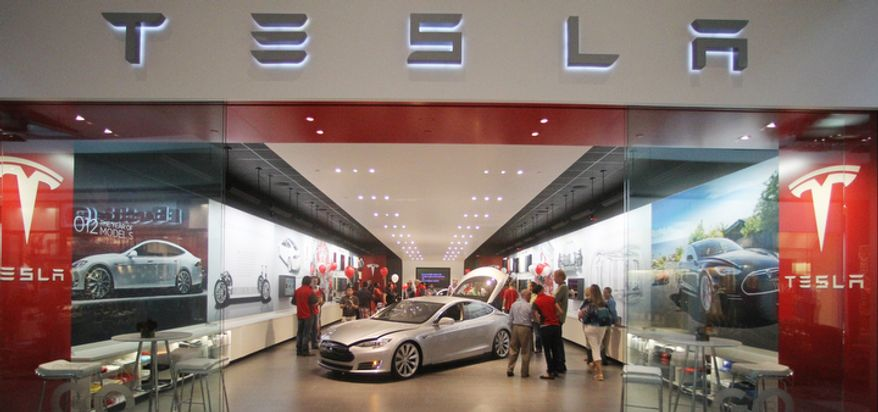 **FILE** The Tesla showroom is seen at the Washington Square Mall in Portland, Ore., on July 20, 2012. (Associated Press)