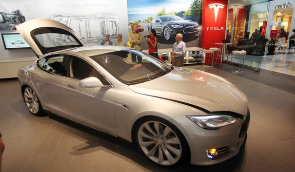 **FILE** A Tesla Model S is shown in the showroom at the Washington Square Mall in Portland, Ore., on  July 20, 2012. (Associated Press)