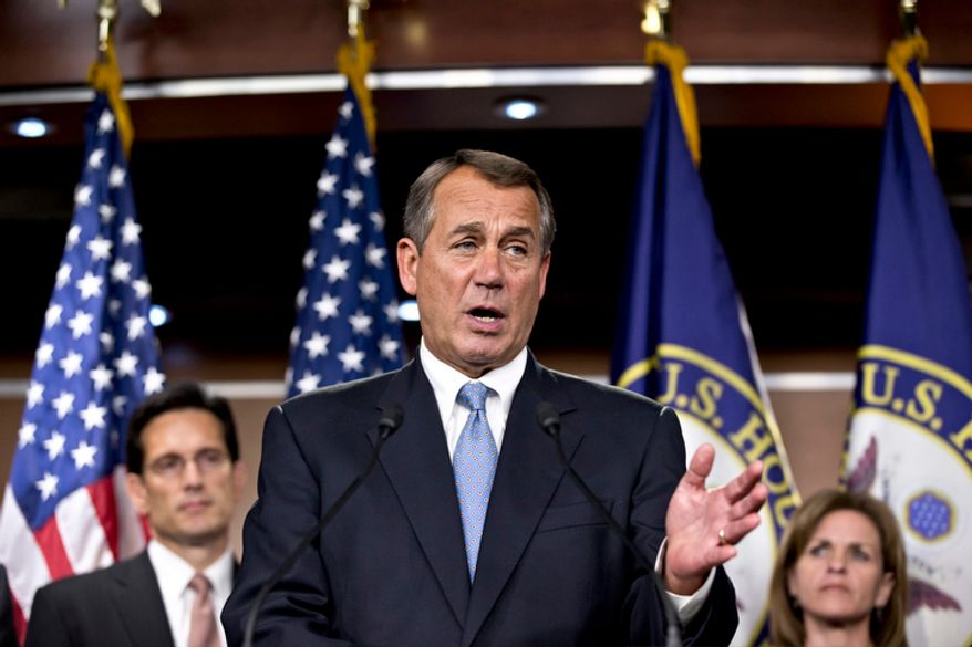**FILE** Speaker of the House John Boehner, Ohio Republican, speaks Nov. 14, 2012, to reporters at the Capitol in Washington after the House Republicans voted for their leadership for the next session of Congress. He is flanked by Majority Leader Eric Cantor (left), Virginia Republican, and Rep. Lynn Jenkins, Kansas Republican. (Associated Press)